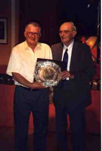 Mr George Baker receiving his 25 year meritorious award from SIL President Mr R Coleman